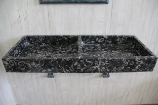 Black marble fossil sink